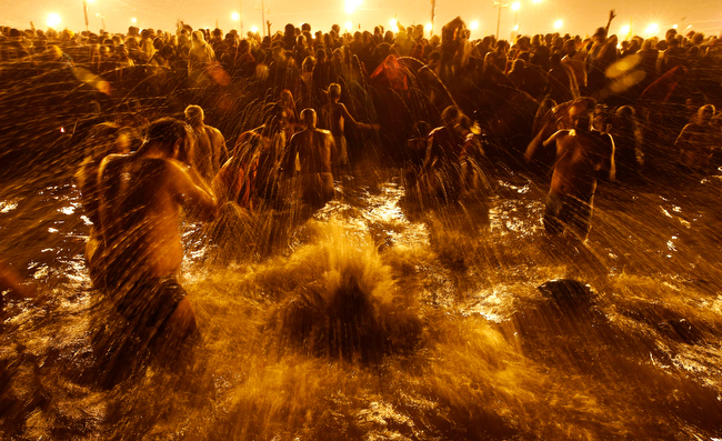 . Hindu devotees take ritual dips at \'Sangam\', confluence of Hindu holy rivers of Ganges, Yamuna and the mythical Saraswati, on the third and last royal bath of the Maha Kumbh festival on occasion of \'Basant Panchami\' in Allahabad, India, Friday, Feb. 15, 2013. Millions of Hindu pilgrims are attending the Maha Kumbh festival, which is one of the world\'s largest religious gatherings that lasts 55 days and falls every 12 years. During the festival pilgrims bathe in the holy Ganges River in a ritual they believe can wash away their sins. (AP Photo/ Saurabh Das)
