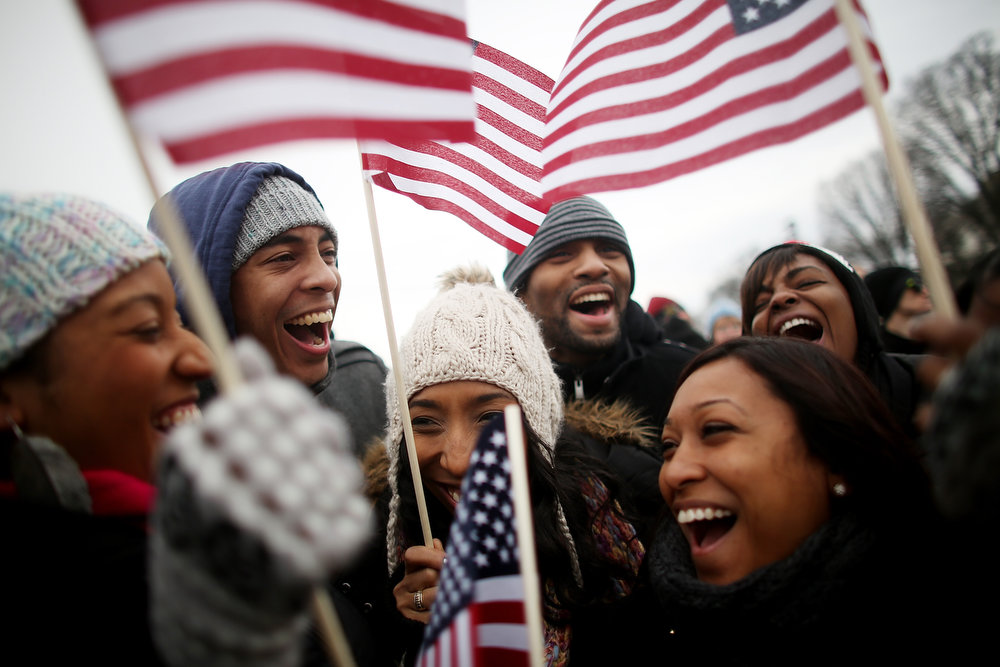 . (FRONT L to R) Donica Perez, Shani Perez and Janelle Stewart from Brooklyn celebrate near the U.S. Capitol building on the National Mall while attending the public Inauguration ceremony on January 21, 2013 in Washington, DC. U.S. President Barack Obama was ceremonially sworn in for his second term today.  (Photo by Mario Tama/Getty Images)