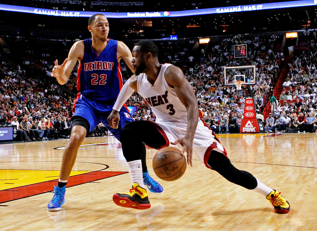 . Miami Heat guard Dwyane Wade (3) drives to the basket as Detroit Pistons forward Tayshaun Prince defends during the second half of an NBA basketball game, Sunday, March 29, 2015, in Miami. The Heat won 109-102. (AP Photo/Joe Skipper)