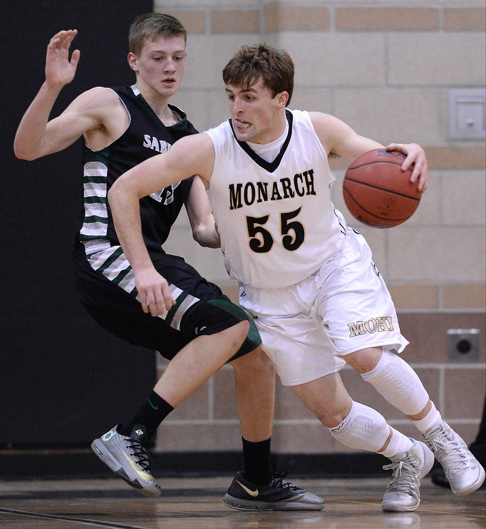 . Jay Maclntyre of Monarch High School (55) controls the ball against Sawyer Novak of Fossil Ridge High School (13) in the 2nd half of the game at Monarch High School Gym.   (Photo by Hyoung Chang/The Denver Post)