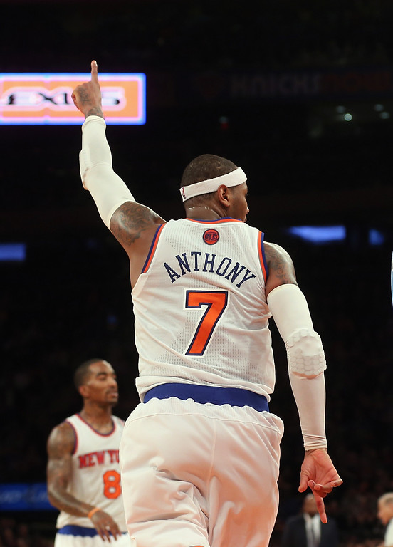 . Carmelo Anthony #7 of the New York Knicks reacts after scoring two late in the fourth quarter against the Denver Nuggets at Madison Square Garden on December 9, 2012 in New York City.  The Knicks defeated the Nuggets 112-106.  (Photo by Bruce Bennett/Getty Images)