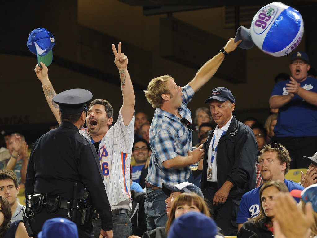 . Unruly Mets fans are corralled by LAPD officers. Fans at Dodger Stadium have been treated to a lot of excitement. The Dodgers defeated the New York Mets 5-4 in 12 innings Wednesday night at Dodger Stadium in Los Angeles, CA. 8/14/2013   (John McCoy/LA Daily News)