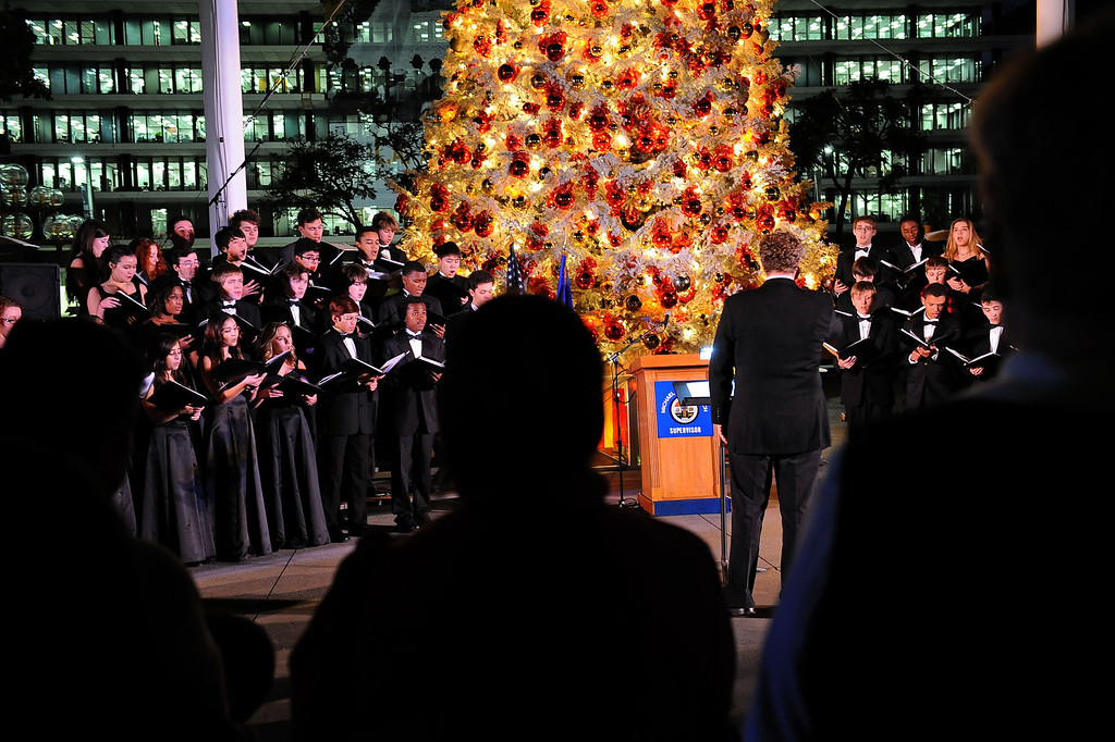 . Singers from the Los Angeles County High School of the Arts perform holiday classics during the annual lighting of the Los Angeles County Christmas Tree December 2 , 2013 in Los Angeles, CA.  The 50-foot tree is located in front of the  Los Angeles County Music Center in downtown Los Angeles.(Andy Holzman/Los Angeles Daily News)