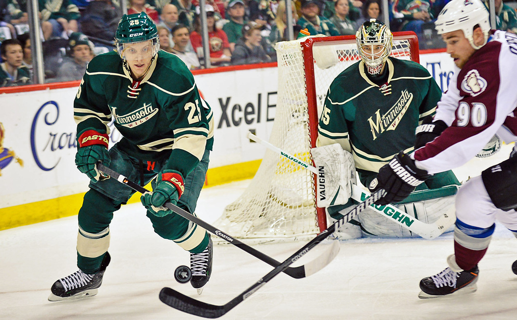 . Wild defenseman Jonas Brodin, left, and Colorado Avalanche center Ryan O\'Reilly chase the puck in the first period.  (Pioneer Press: Ben Garvin)