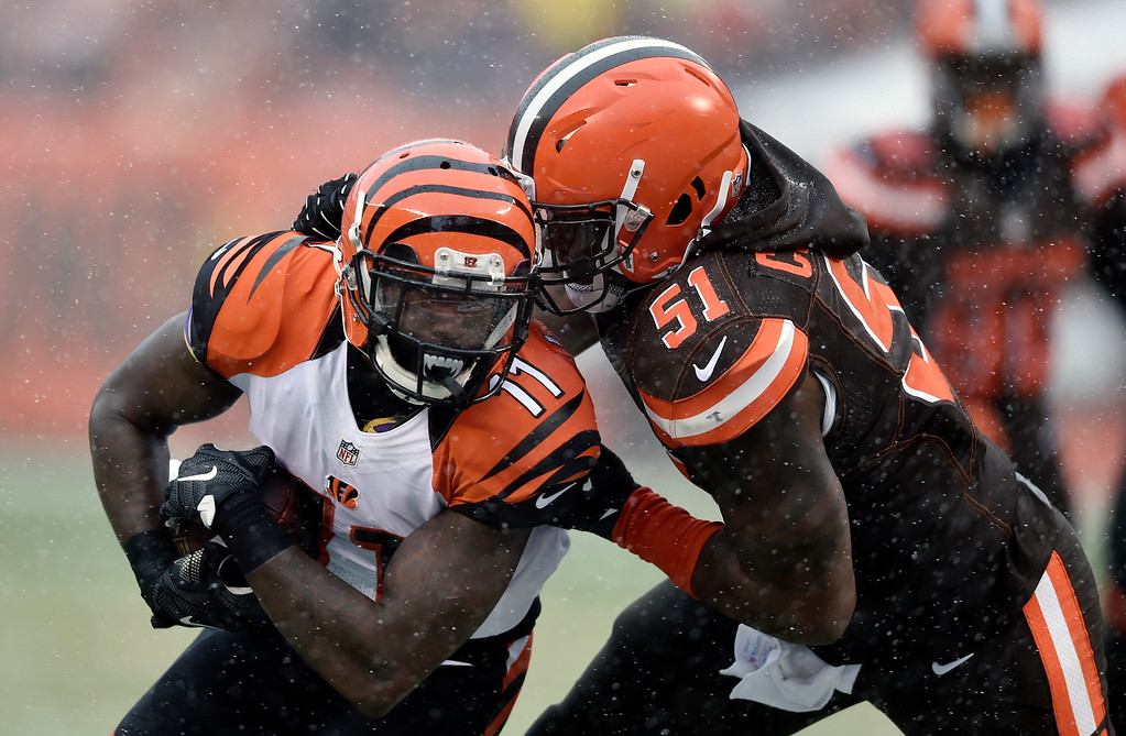 . Cincinnati Bengals wide receiver Brandon LaFell (11) tackled by Cleveland Browns outside linebacker Jamie Collins (51) after a catch in the first half of an NFL football game, Sunday, Dec. 11, 2016, in Cleveland. (AP Photo/David Richard)