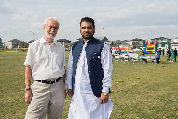 DAVID LIPNOWSKI / WINNIPEG FREE PRESS  (L-R) Former MLA and provincial cabinet minister Tim Sale and Vice President of The University of Manitoba's Pakistani Students' Association Moazzam Faisal pose for a photo prior to the beginning of festivities celebrating Pakistan's Independence Day and Eid Sunday August 19, 2018 at Jinnah Park.