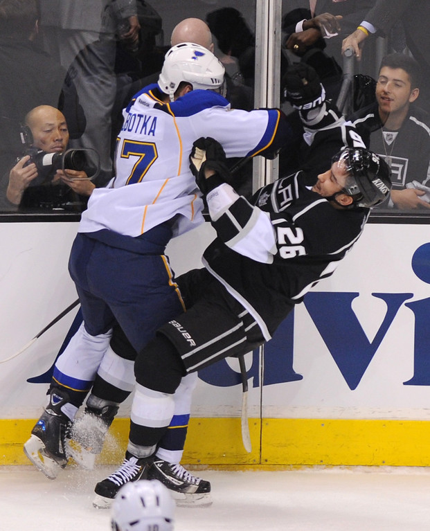 . The St. Louis Blues Vladimir Sobotka levels the Kings\' Slava Voynov in the first period, Monday, May 6, 2013, at Staples Center. (Michael Owen Baker/Staff Photographer)