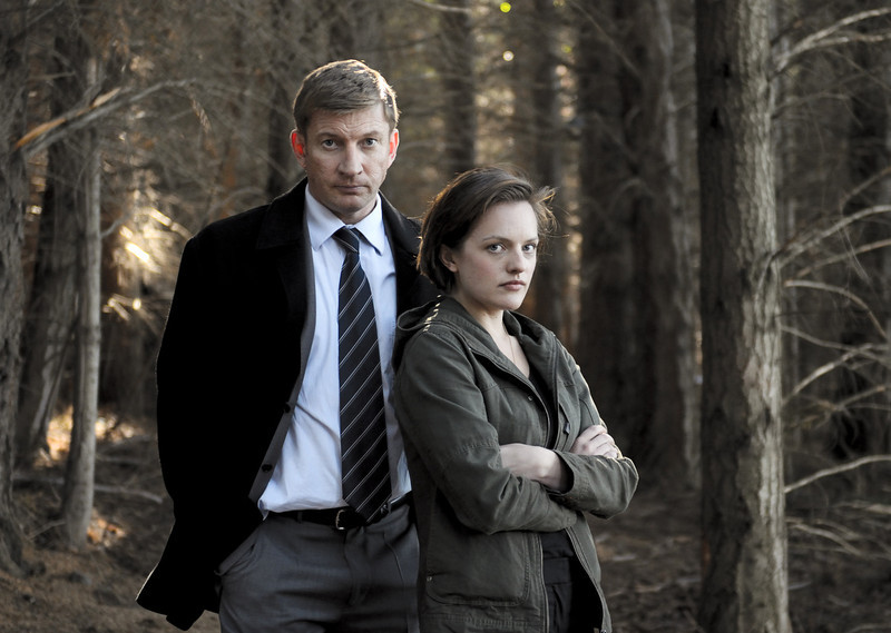 ". This undated publicity image released by Sundance Channel shows David Wenham, left, and Elisabeth Moss in the Sundance Channel original miniseries ""Top of the Lake\"". Moss was nominated for an Emmy Award for best actress in a miniseries or movie on Thursday July 18, 2013.  The program was also nominated for outstanding movie or miniseries.The Academy of Television Arts & Sciences\' Emmy ceremony will be hosted by Neil Patrick Harris. It will air Sept. 22 on CBS. (AP Photo/Sundance Channel, Parisa Taghizadeh)"