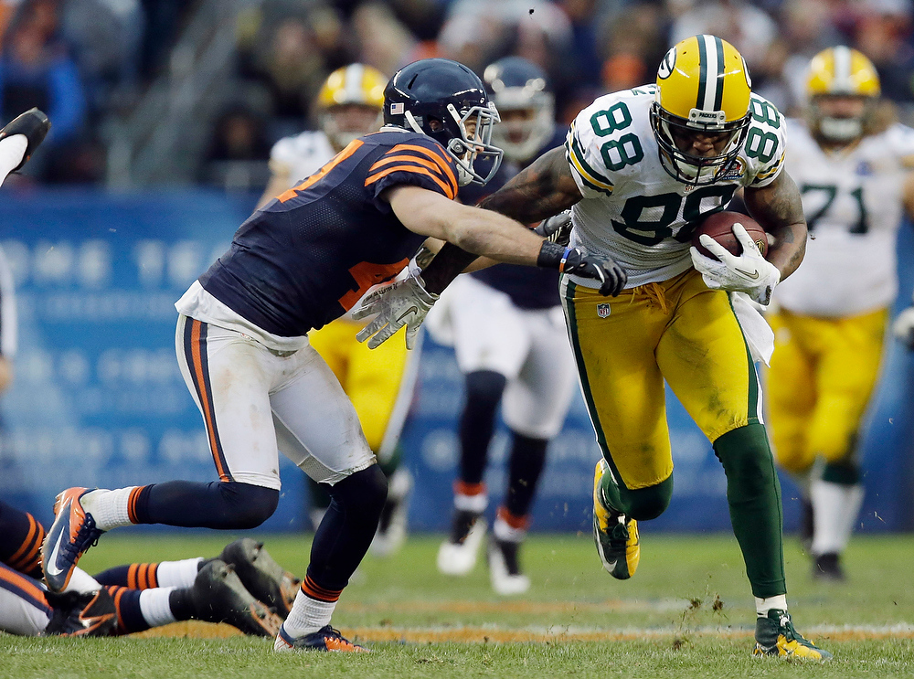 . Green Bay Packers tight end Jermichael Finley (88) is pursued by Chicago Bears safety Chris Conte in the second half of an NFL football game in Chicago, Sunday, Dec. 16, 2012. The Packers won 21-13 to clinch the NFC North division title.(AP Photo/Nam Y. Huh)