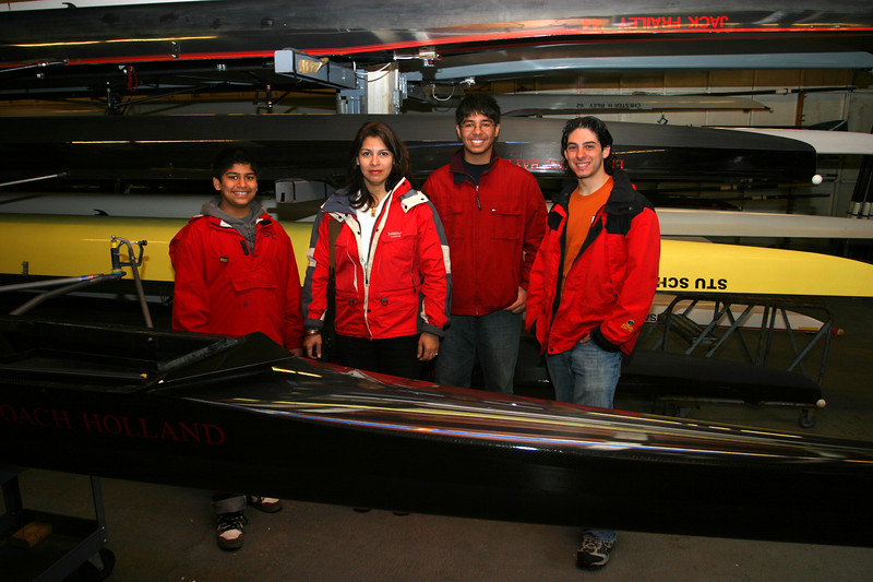 Zeryab, Saadia, Daanyal and Jeff in the boathouse in front of Jeff's varsity boat.