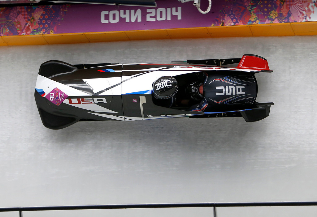 . USA-3 driven by Nick Cunningham, left, with Dallas Robinson head down turn 11 during Heat 3 of the Two-man Bobsleigh at the Sliding Center Sanki for the 2014 Winter Olympics in Krasnaya Polyana, Russia on Monday, Feb. 17, 2014.  (Nhat V. Meyer/Bay Area News Group)