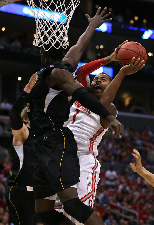 . LOS ANGELES, CA - MARCH 30:  Deshaun Thomas #1 of the Ohio State Buckeyes goes up for a shot against Ehimen Orukpe #21 of the Wichita State Shockers in the first half during the West Regional Final of the 2013 NCAA Men\'s Basketball Tournament at Staples Center on March 30, 2013 in Los Angeles, California.  (Photo by Jeff Gross/Getty Images)