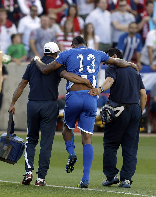 . Honduras\' Carlo Costly (13) is helped off the field after being injured in the first half during a World Cup qualifying soccer match against the United States, at Rio Tinto Stadium on Tuesday, June 18, 2013, in Sandy, Utah. (AP Photo/Rick Bowmer)