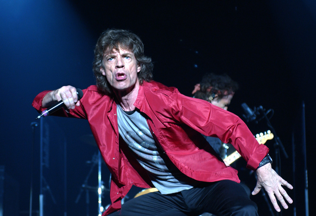 . Mick Jagger of The Rolling Stones performs during the Licks world tour 2002-2003, in New York, Monday, Sept. 30, 2002. (AP Photo/ Louis Lanzano)