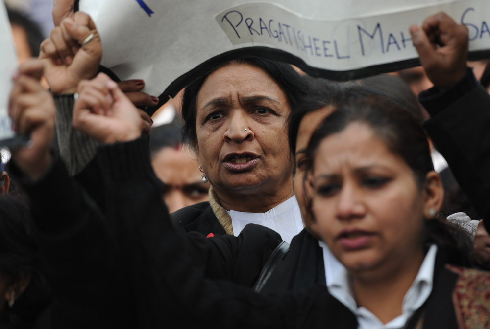 . Indian lawyers shout slogans as they hold placards during a protest at the entrance to Saket District Court in New Delhi on January 3, 2013. A gang of men accused of repeatedly raping a 23-year-old student on a moving bus in New Delhi in a deadly crime that repulsed the nation are to appear in court for the first time. Police are to formally charge five suspects with rape, kidnapping and murder after the woman died at the weekend from the horrific injuries inflicted on her during an ordeal that has galvanised disgust over rising sex crimes in India.  SAJJAD HUSSAIN/AFP/Getty Images