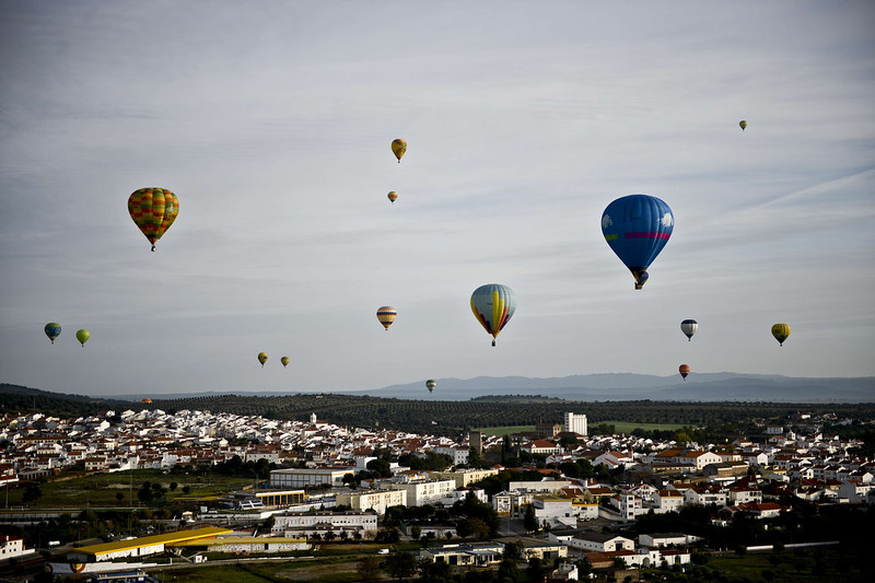 . Balloons fly over a town during the 18th International Festival of Hot Air Balloons in Alter do Chao in the center of Portugal on November 10 2014. PATRICIA DE MELO MOREIRA/AFP/Getty Images