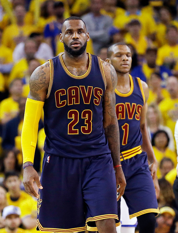 . Cleveland Cavaliers forward LeBron James (23) and forward James Jones (1) walk on the floor during the second half of Game 5 of basketball\'s NBA Finals against the Golden State Warriors in Oakland, Calif., Sunday, June 14, 2015. The Warriors won 104-91. (AP Photo/Ben Margot)