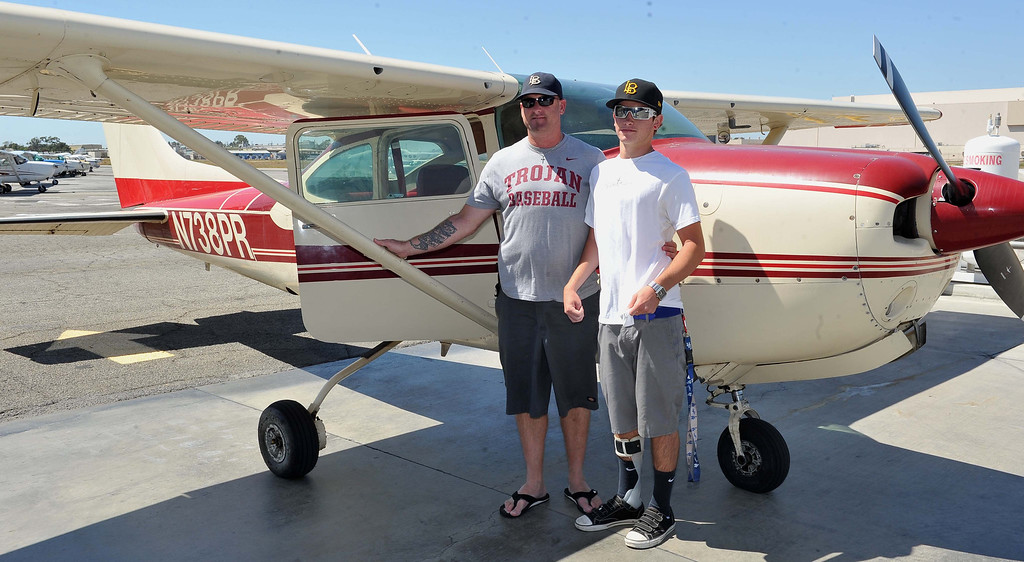 . 8/21/13 - L-R Kevin Nicolau  and his son Kadin Nicolau after flying on Wednesday afternoon. Pediatric rehabilitation patients from Miller Children�s Hospital Long Beach got experience their first �Discovery Flight� at the California Flight Center. After some training from the pilots the kids got to actually pilot the plane on their own. The program which uses volunteer pilots has taken 125 kids in the air. Photo by Brittany Murray, Press Telegram