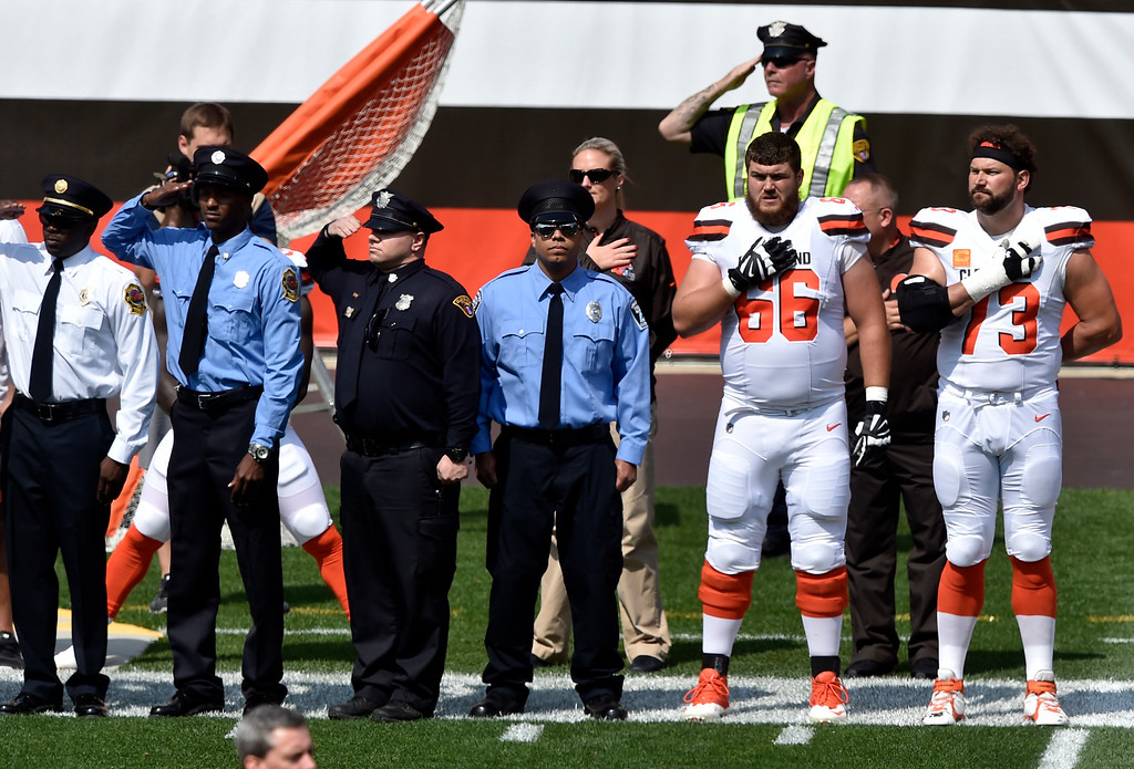. Members of the Cleveland police and the Cleveland Browns players stand together during the national anthem before an NFL football game between the Pittsburgh Steelers and the Cleveland Browns, Sunday, Sept. 10, 2017, in Cleveland. (AP Photo/David Richard)