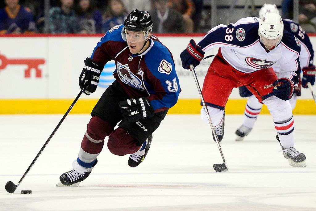 . Paul Stastny (26) of the Colorado Avalanche brings the puck into the open ice as Boone Jenner (38) of the Columbus Blue Jackets pursues during the third period of Colorado\'s 5-3 win.   (Photo by AAron Ontiveroz/The Denver Post)