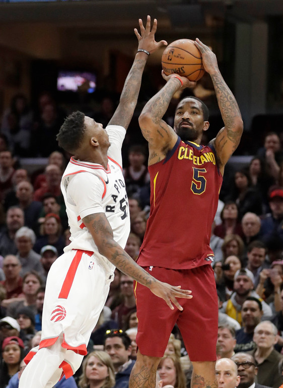 . Cleveland Cavaliers\' JR Smith (5) shoots over Toronto Raptors\' Delon Wright (55) during the second half of an NBA basketball game Wednesday, March 21, 2018, in Cleveland. The Cavaliers won 132-129. (AP Photo/Tony Dejak)