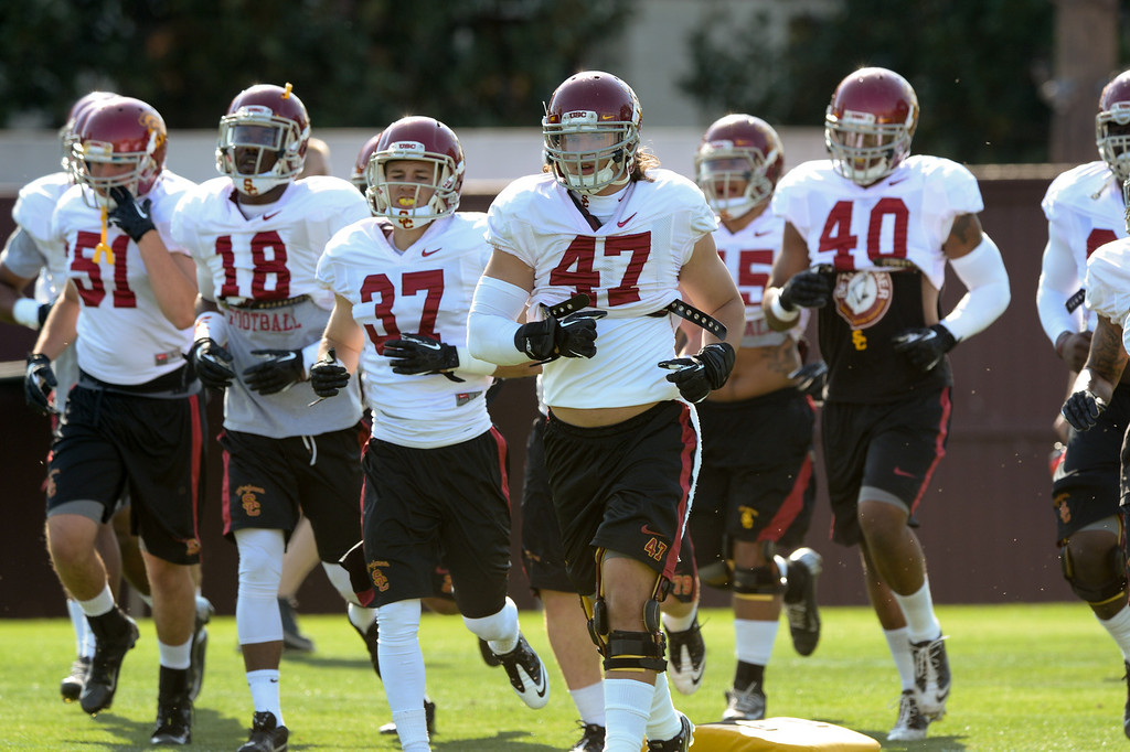 . The defense runs to a new drill station at practice, Thursday, March 27, 2014, at USC. (Photo by Michael Owen Baker/L.A. Daily News)