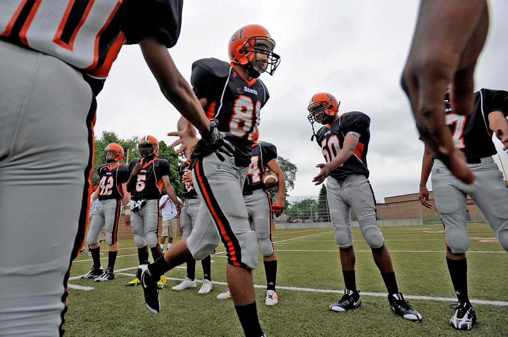 . St. Paul Humboldt freshman tight end Michael King slaps hands as he runs onto the field before the start of the Hawks\' game against Minneapolis Edison.  (Special to the Pioneer Press: A.J. Olmscheid)