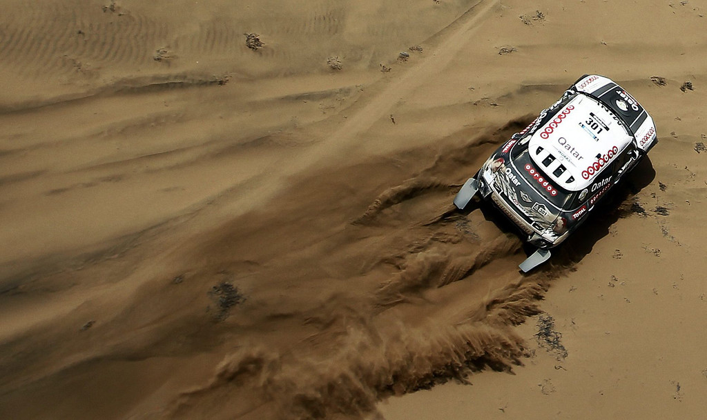 . Nasser Al-Attiyah from Qatar in action during the 12th stage of the Dakar Rally 2014 between the Chilean localities of El Salvador and La Serena, 17 January 2014. The rally takes place in Argentina, Bolivia and Chile from 04 to 18 January 2014.  EPA/FELIPE TRUEBA