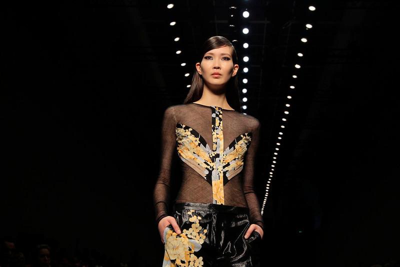 . A model presents a creation by Italian designer Raffaele Borriello as part of his Fall-Winter 2013/2014 women\'s ready-to-wear fashion show for fashion house Leonard during Paris fashion week March 4, 2013.  REUTERS/Gonzalo Fuentes