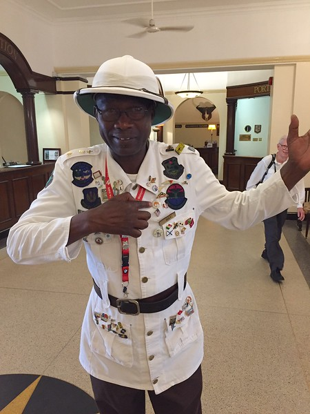 Head porter at the Victoria Falls Hotel adds a Princeton Journeys pin to his regalia - Kristin Appelget