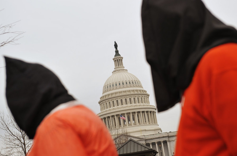 . Demonstrators march past the US Capitol during a rally to call for the closing of the Guantanamo Bay detention center on January 11, 2013 on Capitol Hill in Washington. MANDEL NGAN/AFP/Getty Images