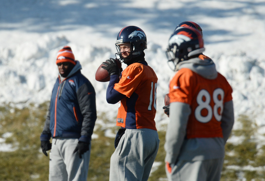 . Peyton Manning of the Denver Broncos (18) warming up on the practice field of Denver Broncos Headquarters at Dove Valley in Englewood, Colorado on Friday, December 6, 2013. (Photo by Hyoung Chang/The Denver Post)