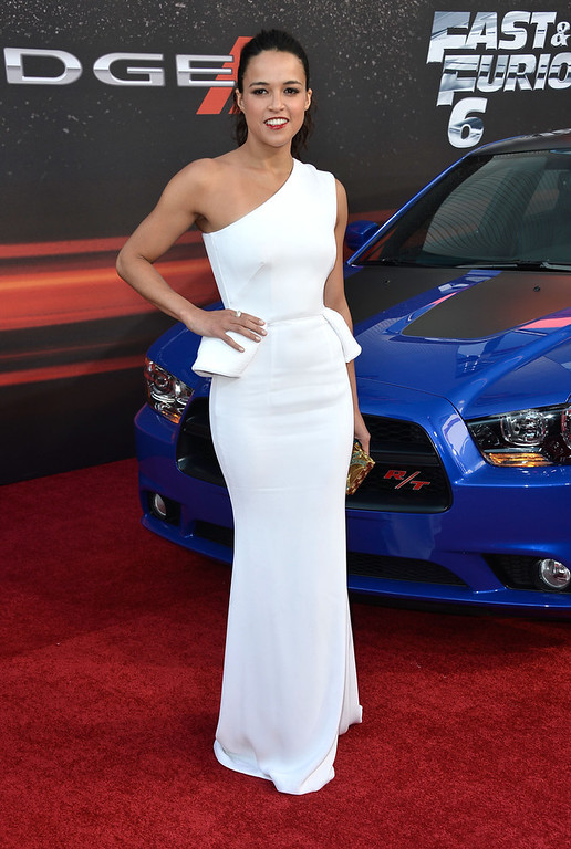 ". Actress Michelle Rodriguez arrives at the Premiere Of Universal Pictures\' ""Fast & Furious 6\"" on May 21, 2013 in Universal City, California.  (Photo by Frazer Harrison/Getty Images)"