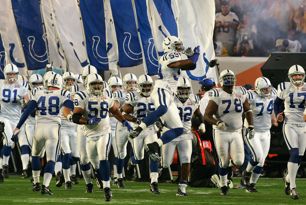 . The Indianapolis Colts run out onto the field during introductions to Super Bowl XLI against the Chicago Bears on February 4, 2007 at Dolphin Stadium in Miami Gardens, Florida.  (Photo by Jed Jacobsohn/Getty Images)