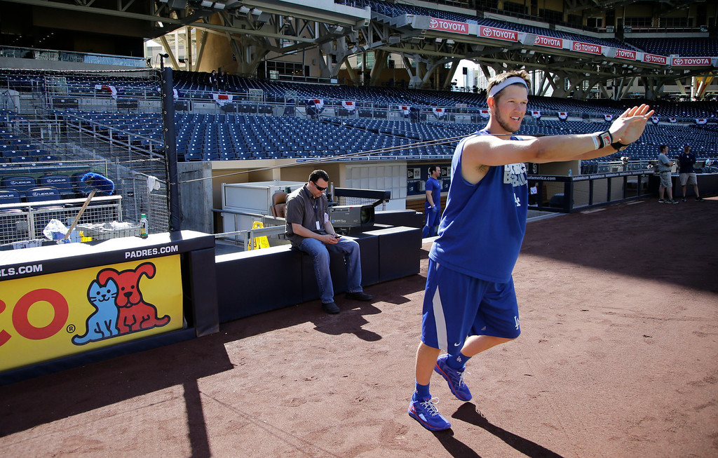 . Los Angeles Dodgers starting pitcher Clayton Kershaw uses bands to stretch with during warmups prior to a baseball gameagainst the San Diego Padres in San Diego, Wednesday, April 10, 2013. (AP Photo/Lenny Ignelzi)