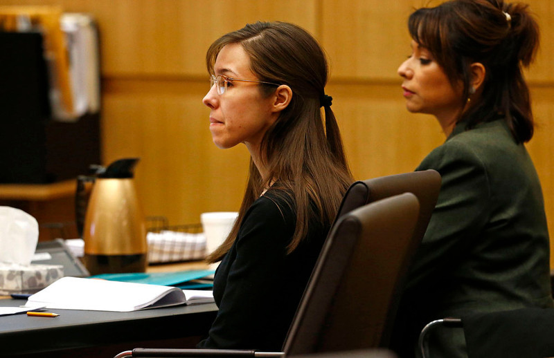 ". Defendant Jodi Arias (L) listens to defense attorney Kirk Nurmi make his closing arguments during her trial at Maricopa County Superior Court in Phoenix, Arizona, May 3, 2013. Defense counsel for Jodi Arias denied in closing arguments on Friday in her high-profile murder trial that she went on a meticulously planned ""covert mission\"" to Arizona expressly to kill her ex-boyfriend and then hide her tracks.  REUTERS/Rob Schumacher/The Arizona Republic/Pool"