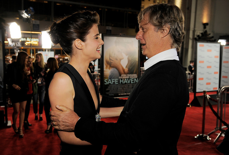 """. Lasse Hallstrom, right, director of \""""Safe Haven,\"""" mingles with cast member Cobie Smulders at the U.S. premiere of the film, Tuesday, Feb. 5, 2013, in the Hollywood section of Los Angeles. (Photo by Chris Pizzello/Invision/AP)"""