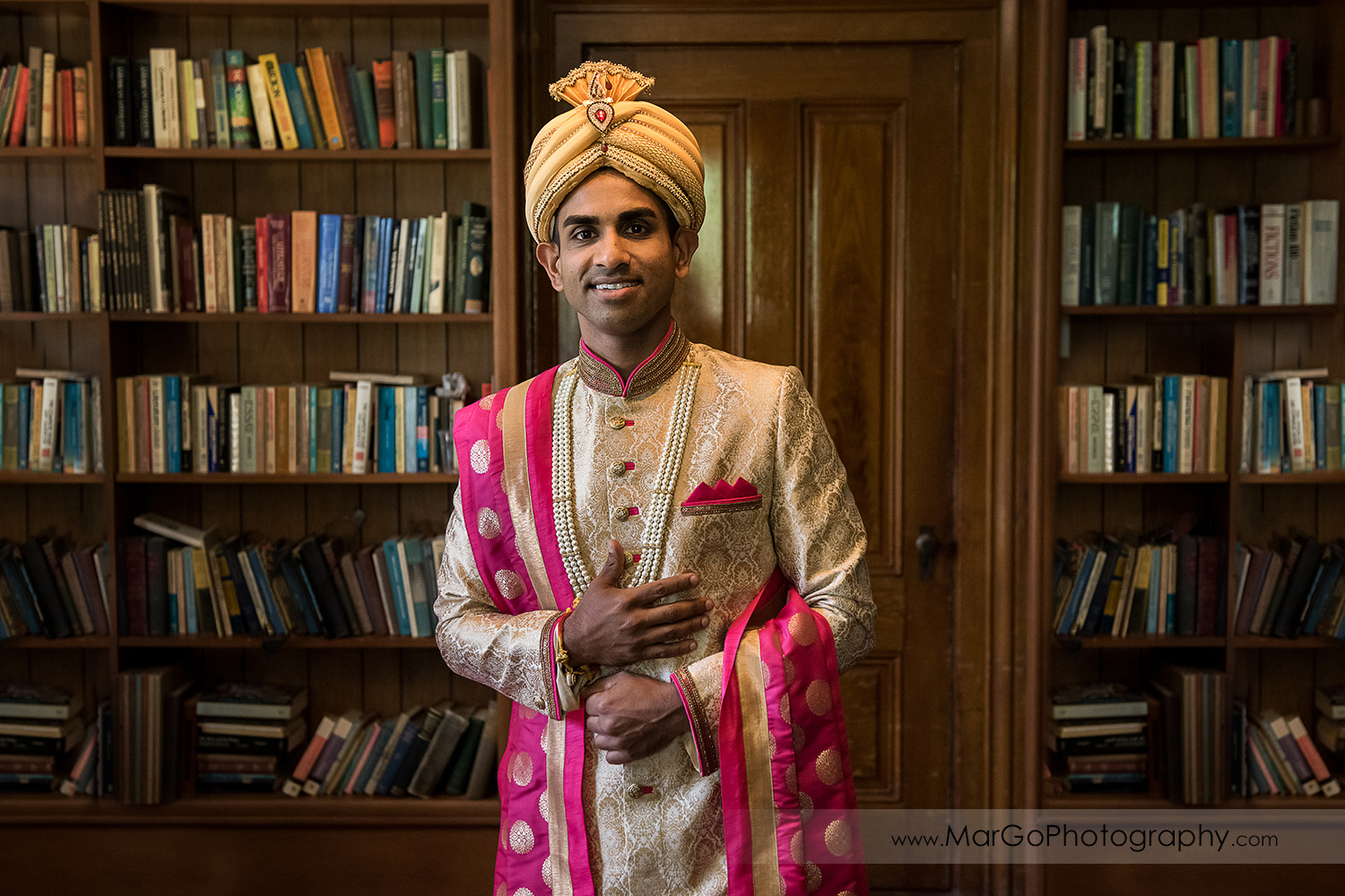 portrait of Indian groom in library at Elliston Vineyards in Sunol