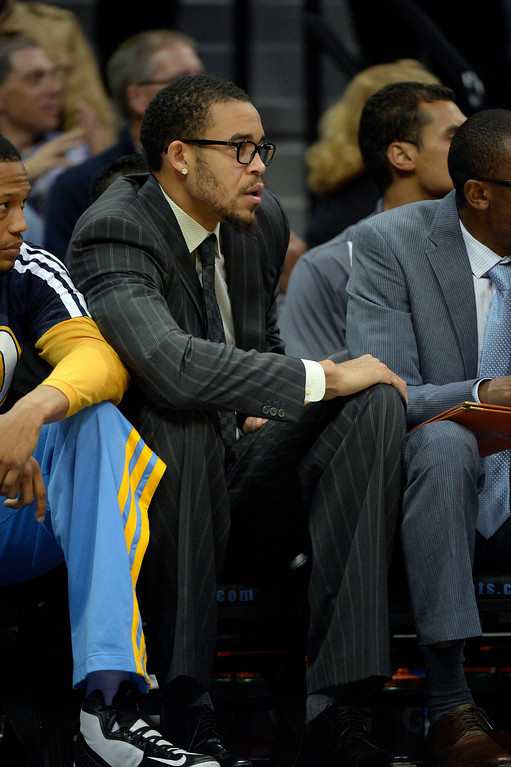 . DENVER, CO - NOVEMBER 13: Denver Nuggets center JaVale McGee watches from the bench in street clothes during the second quarter against the Los Angeles Lakers November 13, 2013 at Pepsi Center. (Photo by John Leyba/The Denver Post)