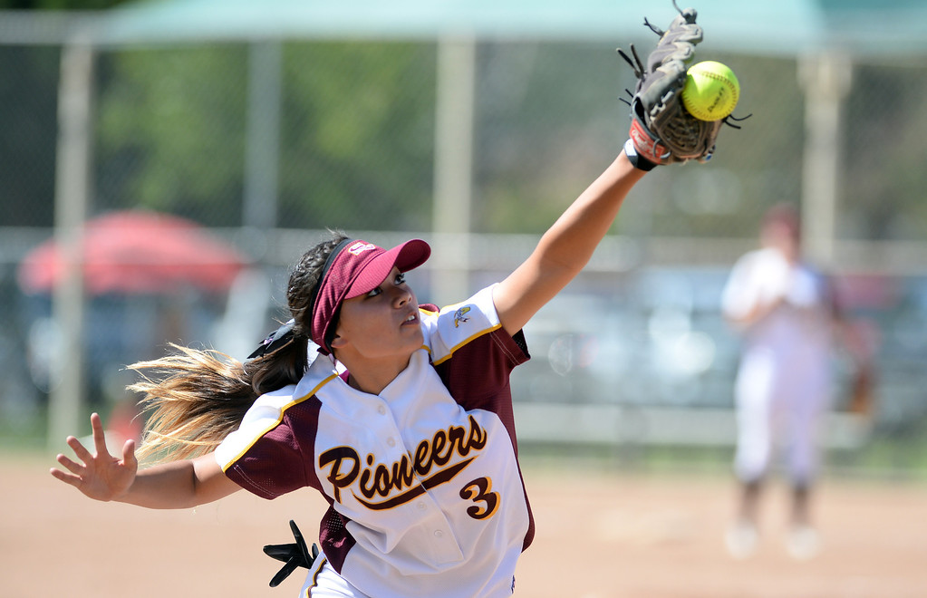 . imi Valley High School\'s Danielle Chatman #3  makes a great attempt to catch a foul ball during their girls softball game against Moorpark High School at  Rancho Santa Susana Community Park in Simi Valley Tuesday April 15, 2014. (Photo by Hans Gutknecht/Los Angeles Daily News)