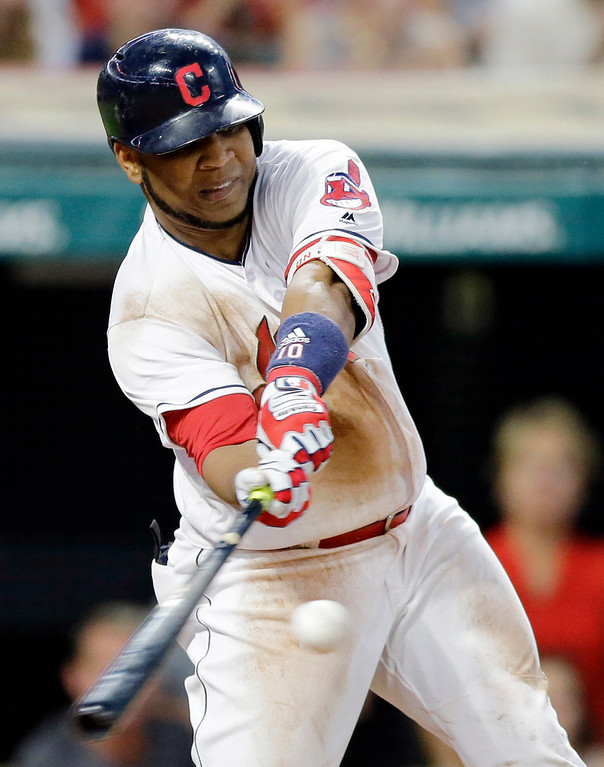 . Cleveland Indians\' Edwin Encarnacion hits a two-run double off Toronto Blue Jays starting pitcher Marco Estrada in the fifth inning of a baseball game, Friday, July 21, 2017, in Cleveland. (AP Photo/Tony Dejak)
