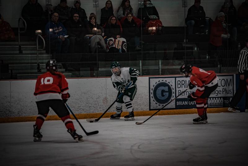 Holy Family Girls Varsity Hockey vs. Mound Westonka, 12/10/19: MacKenzie Moss '22 (3)