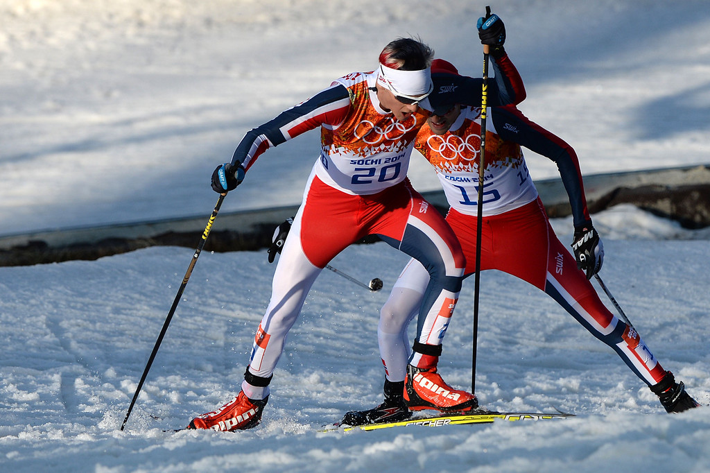 . Bronze medalist Norway\'s Magnus Krog and Norway\'s Magnus Hovdal Moan compete in the Nordic Combined Individual NH / 10 km Cross-Country at the RusSki Gorki Jumping Center during the Sochi Winter Olympics on February 12, 2014, in Rosa Khutor near Sochi.   AFP PHOTO / PETER PARKS/AFP/Getty Images