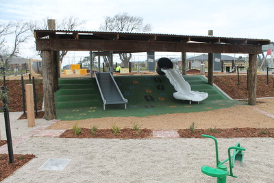 customised slide on mound and post and rail shade structure