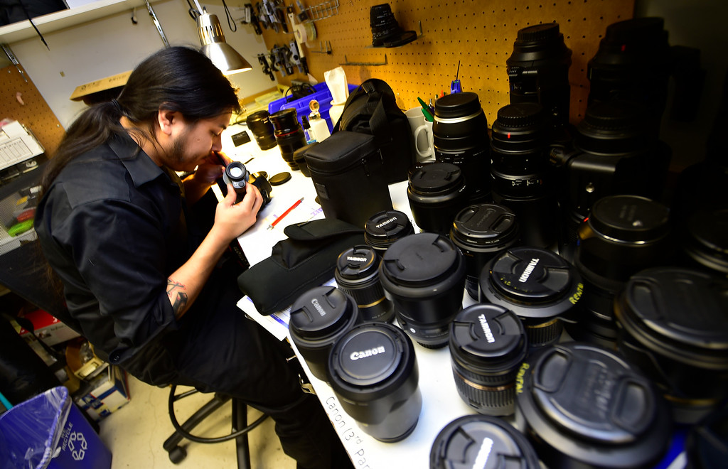 . BOULDER, CO. NOVEMBER 14, 2018 Tony Gomez works in the camera repair area at Mike\'s Camera in Boulder on Wednesday morning.  (Photo by Paul Aiken/Staff Photographer)
