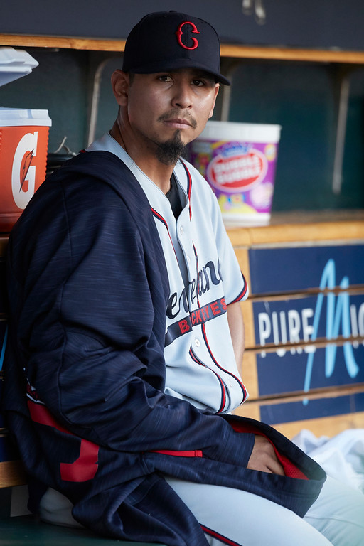 . Cleveland Indians starting pitcher Carlos Carrasco (59) sits in dugout during the second inning against the Detroit Tigers in the second baseball game of a doubleheader in Detroit, Saturday, July 1, 2017. (AP Photo/Rick Osentoski)