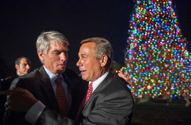 . US Speaker of the House of Representatives John Boehner (R) and US Senator Mark Udall from Colorado are seen after flipping on the lights on the US Capitol Christmas Tree during ceremonies December 4, 2012, on the West Front Lawn of the US Capitol in Washington, DC   PAUL J. RICHARDS/AFP/Getty Images