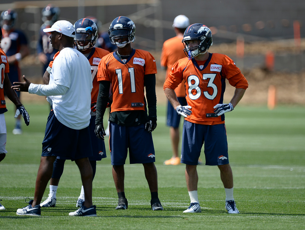 . Denver Broncos wide receiver Jordan Norwood (11) and Denver Broncos wide receiver Wes Welker (83) look on during drills on day two of the Denver Broncos 2014 training camp July 25, 2014 at Dove Valley. (Photo by John Leyba/The Denver Post)