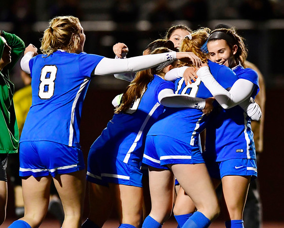 11/19/2019 Mike Orazzi | Staff Southington High School celebrates as time expires during the Class LL Semifinal Girls Soccer match at Naugatuck High School with Ridgefield Tuesday night. Southington advanced to the final 1-0.