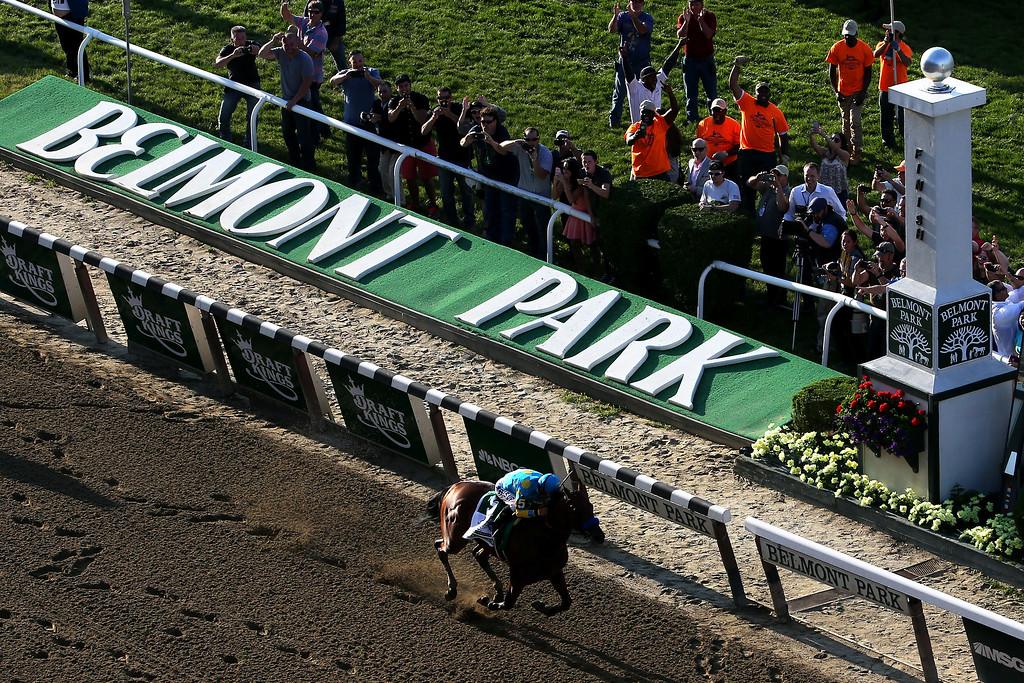 . American Pharoah #5, ridden by Victor Espinoza, crosses the finish line to win the 147th running of the Belmont Stakes at Belmont Park on June 6, 2015 in Elmont, New York.  (Photo by Mike Stobe/Getty Images)